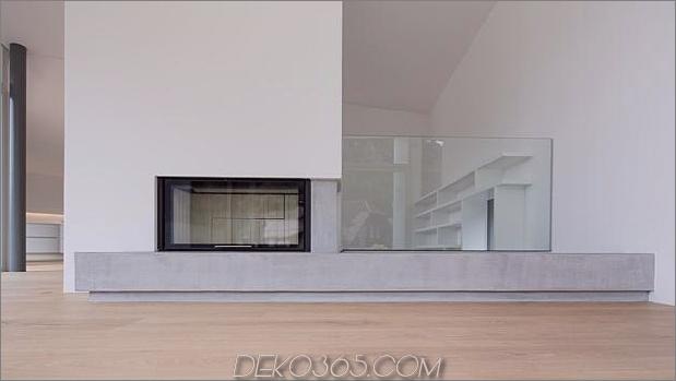3-stöckiges Haus-Steilhang-Gras-überdachte Garage-14-Kamin.jpg