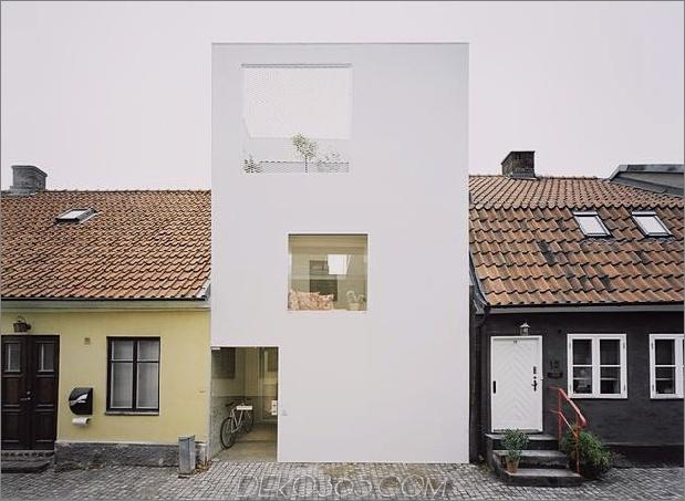 weißes Stadthaus mit offenem Interieur freistehendes Büro 1 gerader Vorderfront 630xauto 45162 Architekt Elding Oscarson Fügt einer verschlafenen schwedischen Straße ein lebendiges weißes Stadthaus hinzu