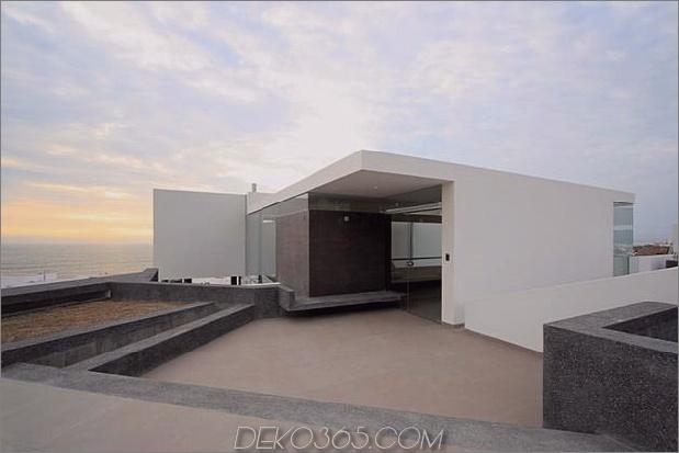 atemberaubend-ultramodern-strandhaus mit glas-wänden-19-eingang.jpg