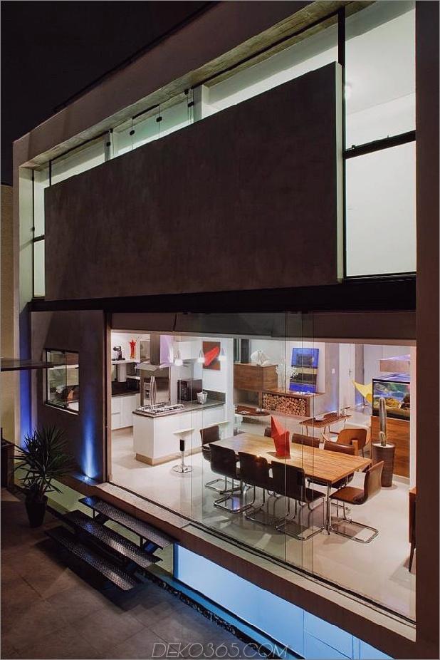 Beton-Würfel-Haus-unterstützt-2-gelbe-ich-Balken-16-Terrasse-Fassade.jpg