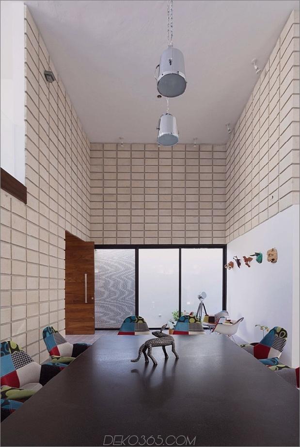 7-c-förmiger Betonblock-Haus-Schwimmbad-Hof.jpg