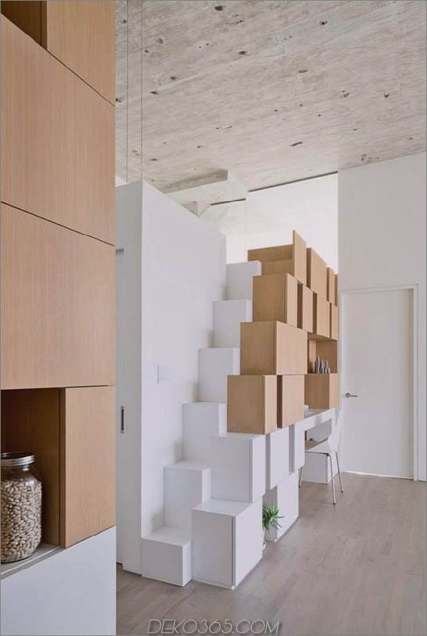 Creative Storage Wall integriert Stairwell in New Mezzanine_5c58e169d84dd.jpg