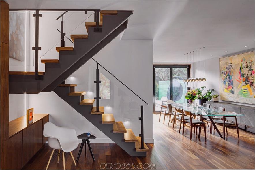 Holz- und Stahltreppen mit Glasgeländer sorgen für eine luftigere Atmosphäre