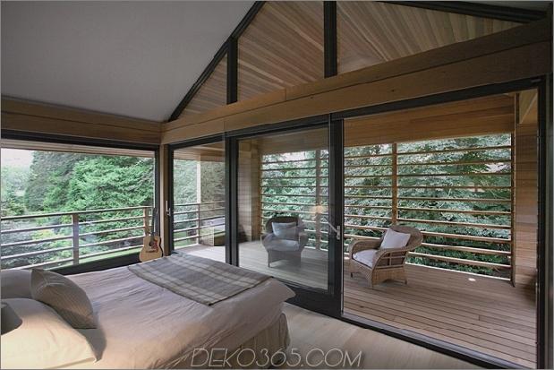Das preisgekrönte Haus der roten Zeder spiegelt sich in Treed-Landschaft_5c58d9f1b9e23.jpg