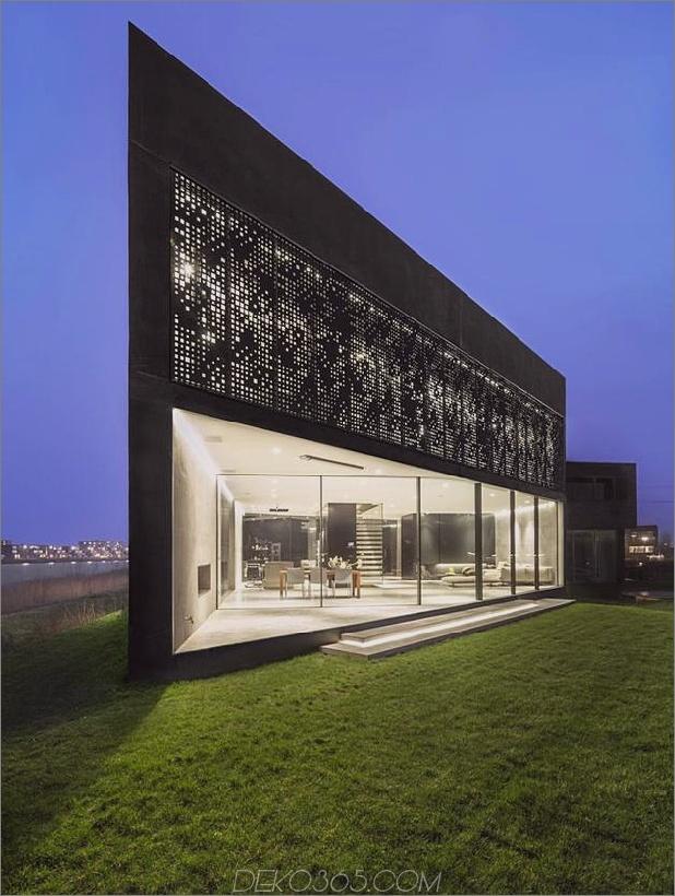 rautenförmiges Haus mit geschwungenen Glasfenstern-8-Nachtlicht.jpg