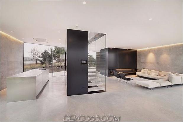 diamantförmiges Haus-mit-kurvigen Glasfenstern-14-Küche-Wohnzimmer.jpg