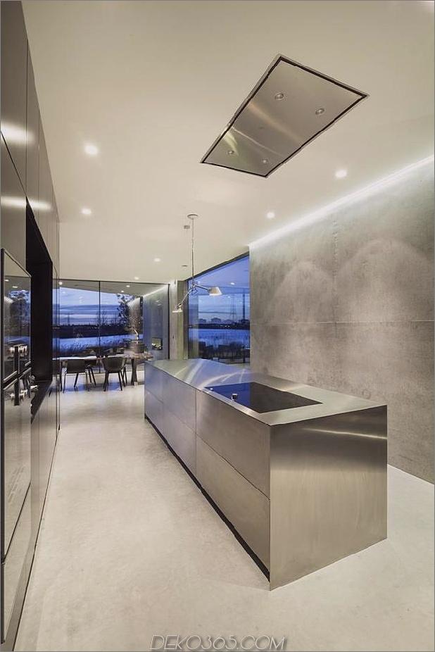 rautenförmiges haus mit geschwungenen glasfenstern-15-kitchen.jpg