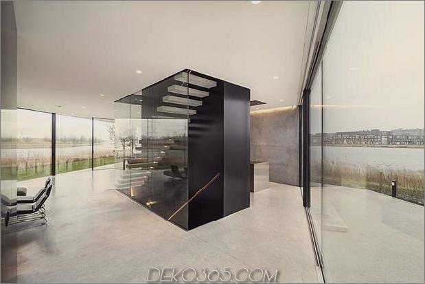 rautenförmiges haus mit geschwungenen glasfenstern-16-treppen.jpg