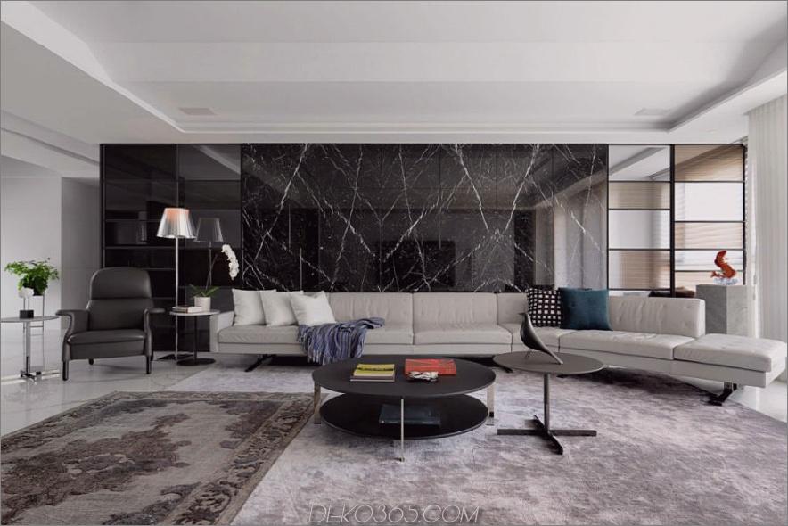 Das lange Sofagarnitur bietet Platz für einige Gäste. 900x600 Dieses taiwanesische Apartment ist luxuriös modern