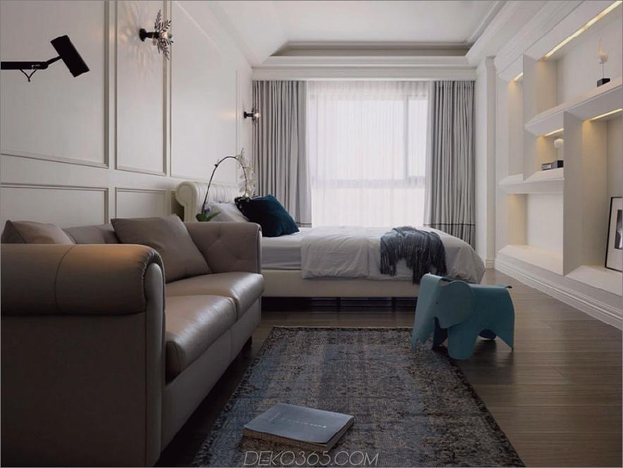 Das palastartige Schlafzimmer verfügt über ein Ledersofa und ein eingebautes asymmetrisches Wandregal