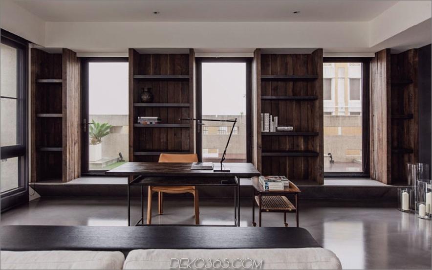 Home-Office grenzt an das Wohnzimmer an und trägt zum modernen, offenen Layout bei 900x561 bei. Dieses stilvolle Betonhaus in Taipei ist raffinierte Einfachheit