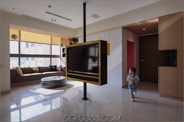 Pivoting-TV-Turns-Playful-Apartment-In-Entertainment-Area-3.jpg