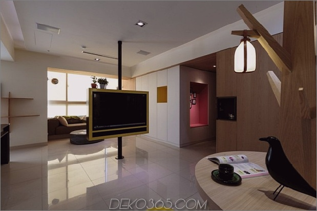 Pivoting-TV-Turns-Playful-Apartment-In-Entertainment-Area-5.jpg