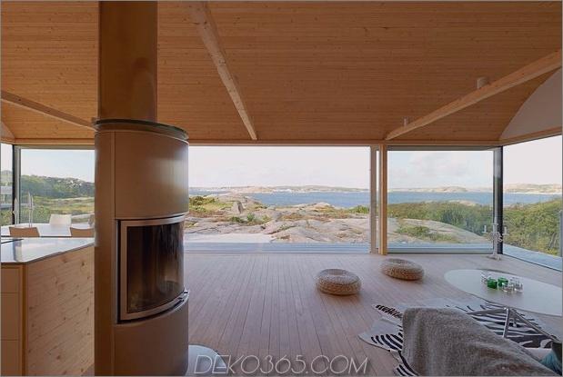 Wellblech-Strandhäuser-mit-Holz-Interieur-9-Kamin.jpg