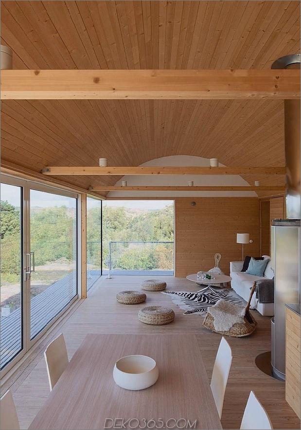 Wellblech-Strandhäuser-mit-Holz-Interieur-12-Tisch-Wohnzimmer.jpg