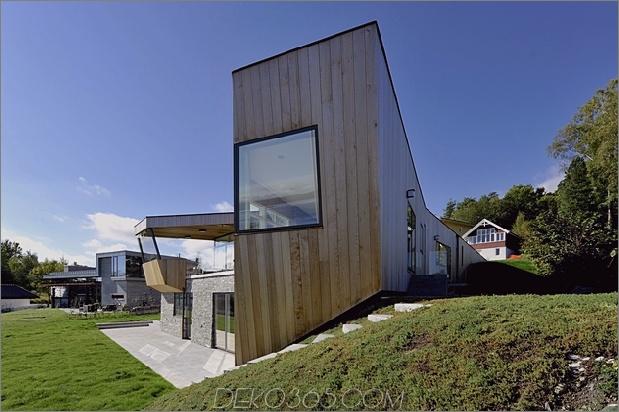 2-stöckiges Haus am Hang auf der Ostseite mit Dächern 630xauto 47794 Das grüne Dach verbindet Strandhaus mit Land