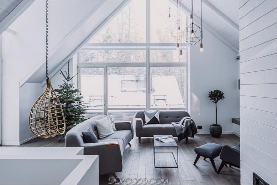 Fenster füllen die Wohnzimmerwand fast vollständig aus 900x601 Haus auf Stelzen im litauischen Wald hat das stilvollste Interieur
