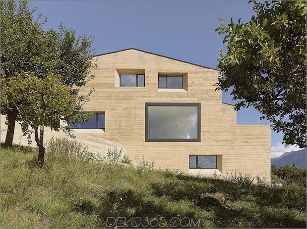 Hanghaus-mit-Holz-Look-Beton-Belag-9-Tage-Seite.jpg