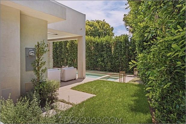 Haus mit mehrstufigen Decks umgeben von Gärten_5c598d6ee25bc.jpg