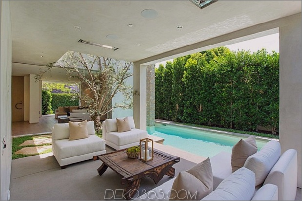 Haus mit mehrstufigen Decks umgeben von Gärten_5c598d714eef7.jpg