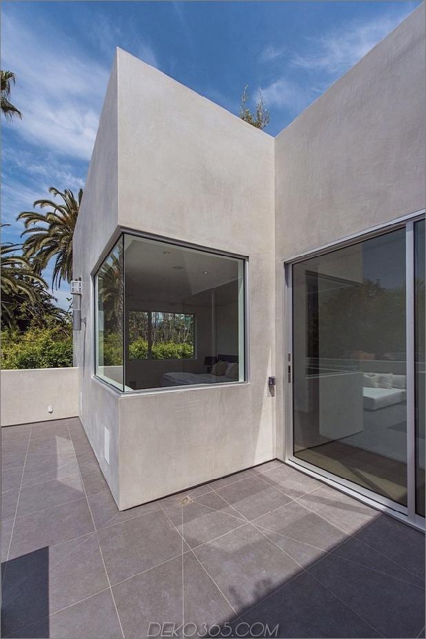 Haus mit mehrstufigen Decks umgeben von Gärten_5c598d7429a4f.jpg