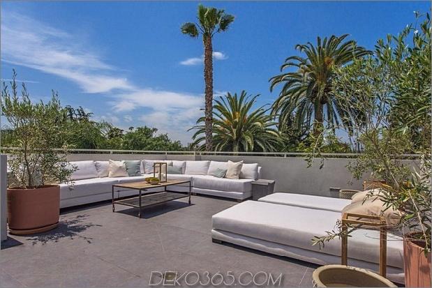 Haus mit mehrstufigen Decks umgeben von Gärten_5c598d77055aa.jpg