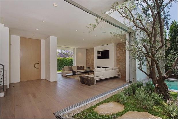 Haus mit mehrstufigen Decks umgeben von Gärten_5c598d79c4777.jpg