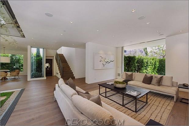 Haus mit mehrstufigen Decks umgeben von Gärten_5c598d7a93fa5.jpg