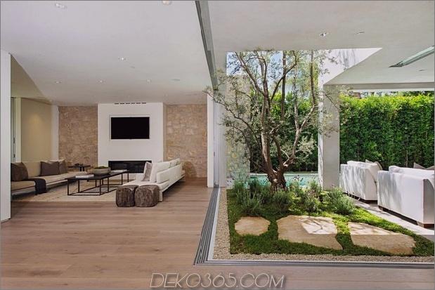 Haus mit mehrstufigen Decks umgeben von Gärten_5c598d7b7f39c.jpg