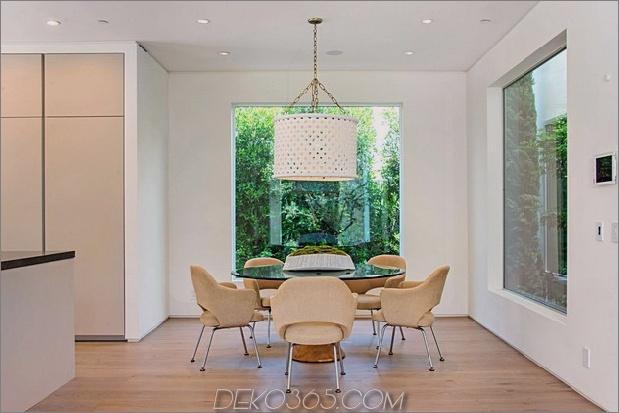 Haus-mit-ebenen-Decks-umgeben von Gärten-33-Küchentisch-gerade.jpg