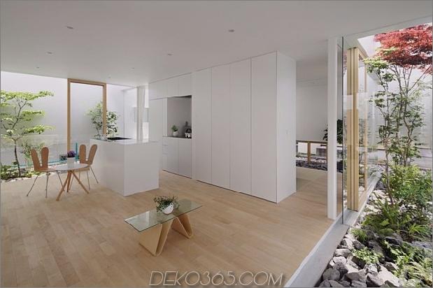 Haus-mit-schwimmende-Fassade-Glas-Wände-und-Innenhof-10.jpg