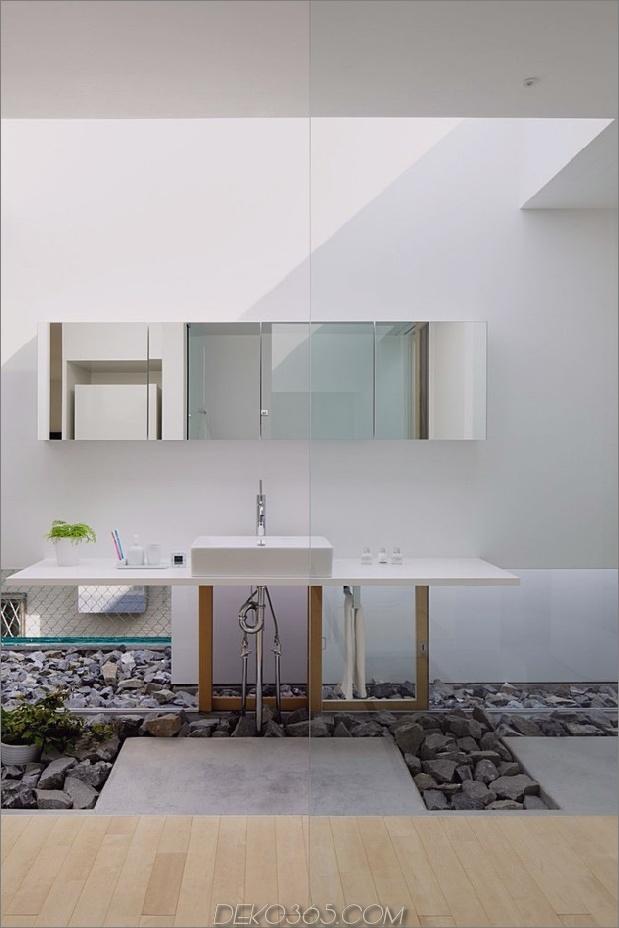 Haus-mit-schwimmende-Fassade-Glas-Wände-und-Innenhof-13.jpg
