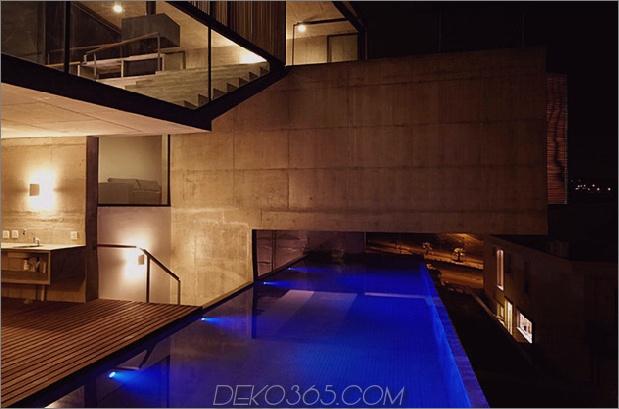 Alfresco-Haus-mit-Hof-Glas-Wände-und-Beton-Interieurs-10.jpg