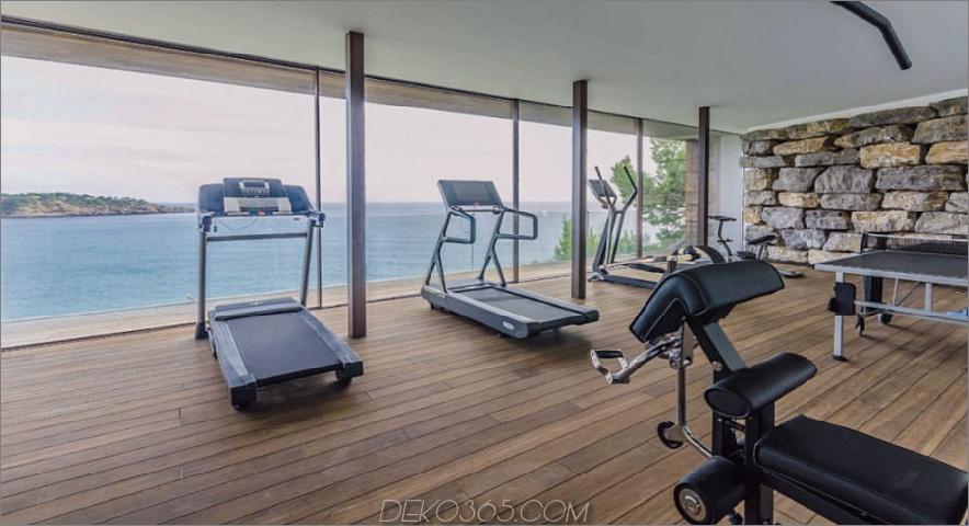 Villa Majesty Fitnessstudio mit Blick auf das Wasser
