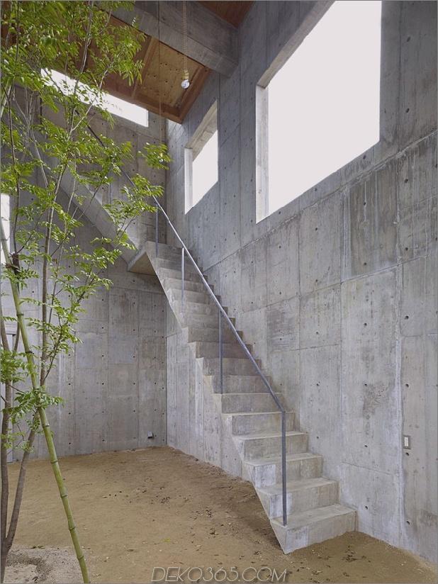 gebogenes betonhaus-mit-innenhof-3.jpg