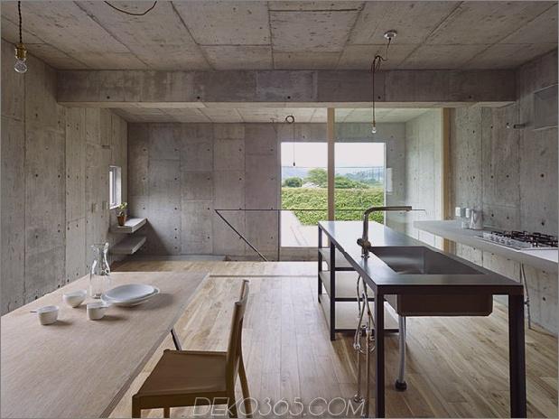 gebogenes betonhaus-mit-innenhof-6.jpg