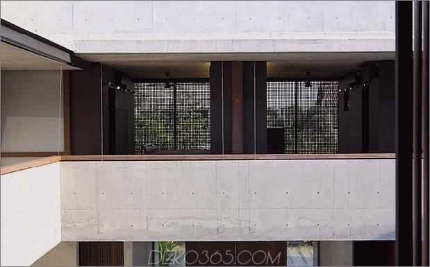Hof-Haus-Open-to-Outdoor-mit skulpturaler Treppe-8.jpg