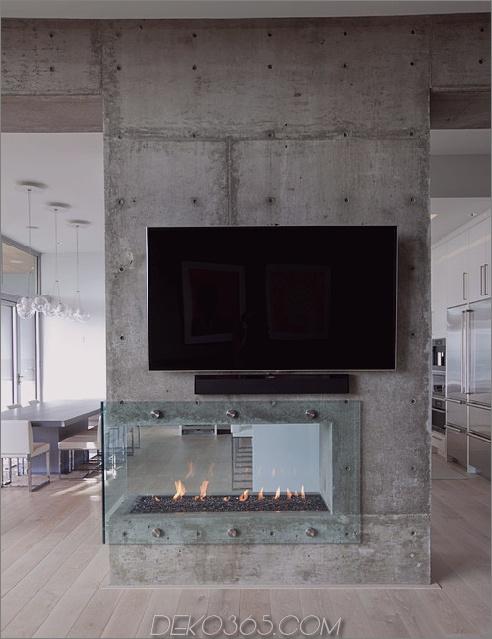 doppelseitig-modern-kamin-raumteiler-beton-und-glas.jpg