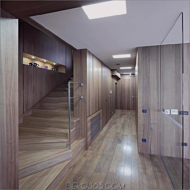skulptural-runder-treppenhaus-fokus-minimalist-residenz-3-foyer.jpg