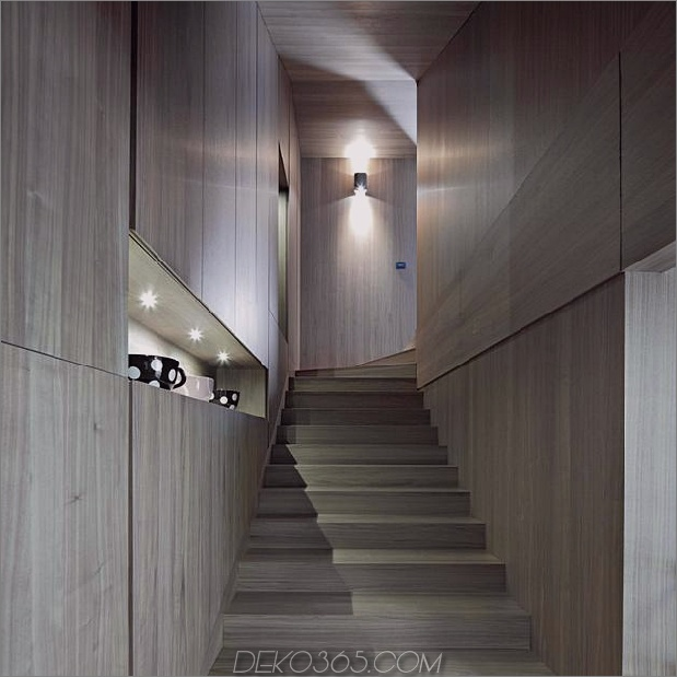 skulptural-rund-treppenhaus-fokus-minimalistisch-residenz-7-foyer-treppen.jpg