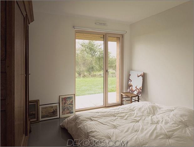 Land-Haus-klare-Linien-Merkmale-Flur-Bücherregale-11-Bett.jpg
