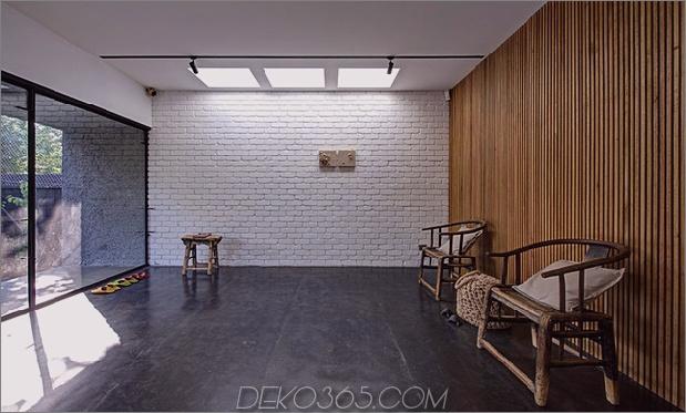 minimalistisches Haus mit schwenkbarer Glaswand und ungewöhnlichen Details-2.jpg