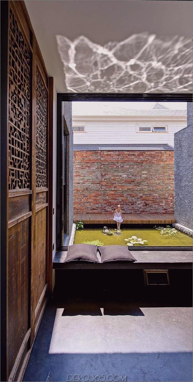 minimalistisches Haus mit schwenkbarer Glaswand und ungewöhnlichen Details-3.jpg