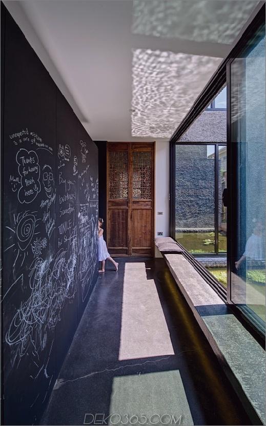 minimalistisches Haus mit schwenkbarer Glaswand und ungewöhnlichen Details-4.jpg