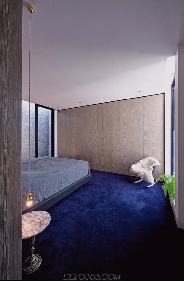 minimalistisches Haus mit schwenkbarer Glaswand und ungewöhnlichen Details-9.jpg