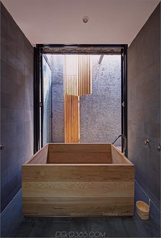 minimalistisches Haus mit schwenkbarer Glaswand und ungewöhnlichen Details-10.jpg