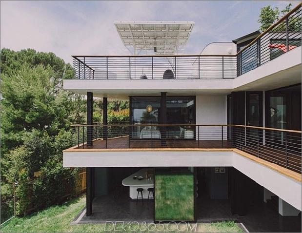 modernistisches Reihenhaus mit verschwindenden Wänden und minimalistischem Interieur-3.jpg