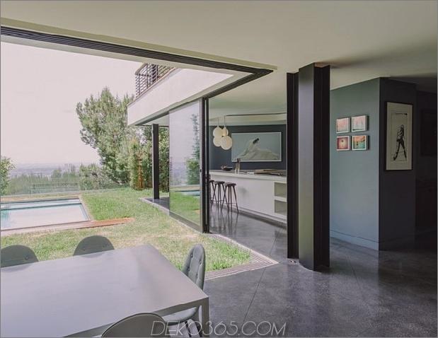 modernistisches Reihenhaus mit verschwindenden Wänden und minimalistischem Interieur-8.jpg