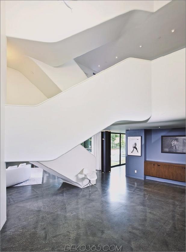 modernistisches Reihenhaus mit verschwindenden Wänden und minimalistischem Interieur-13.jpg