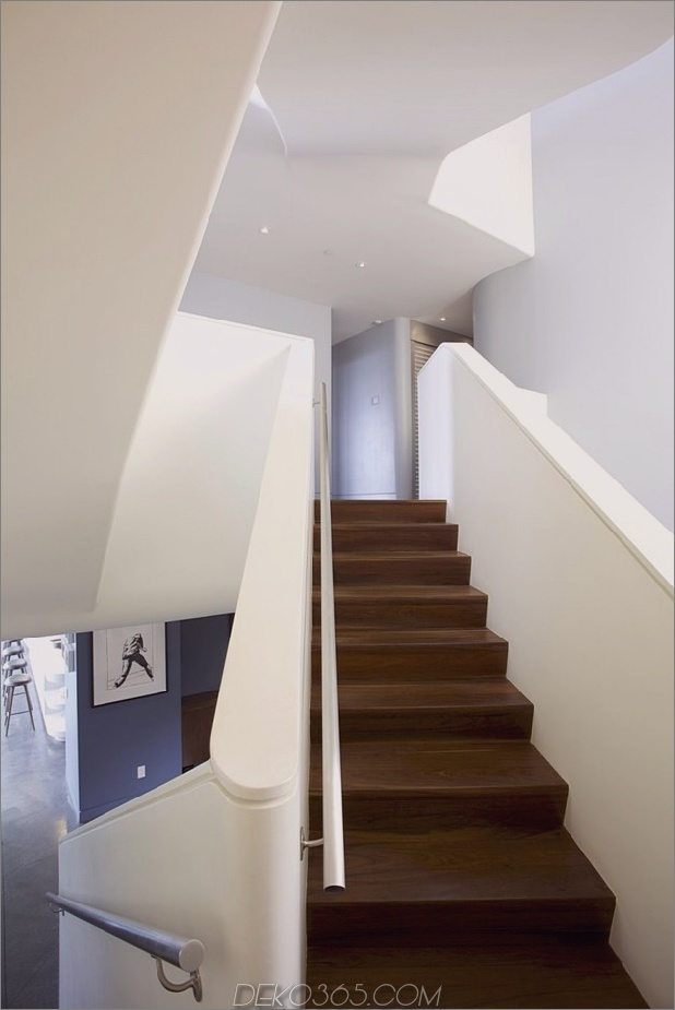 modernistisches Reihenhaus mit verschwindenden Wänden und minimalistischem Interieur-15.jpg